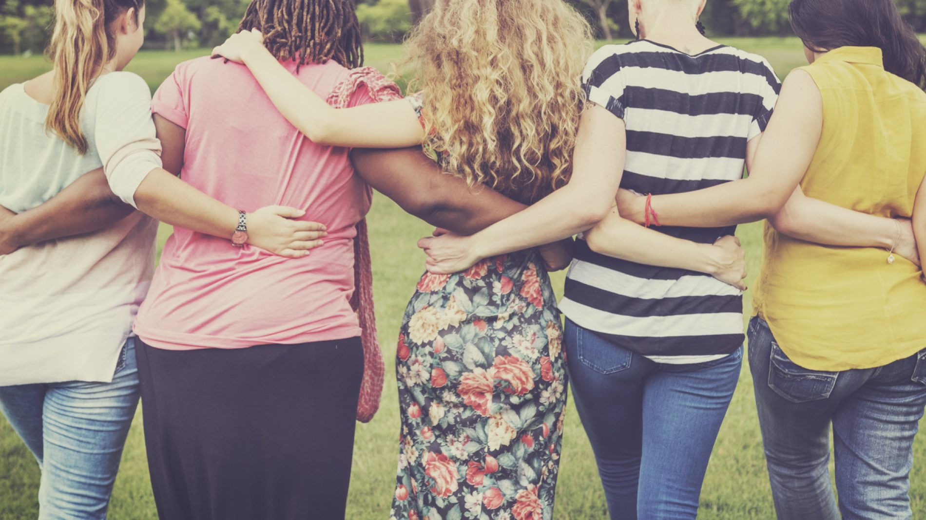 5 women linking each other