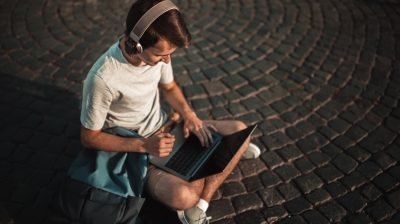 College student with laptop and headphones