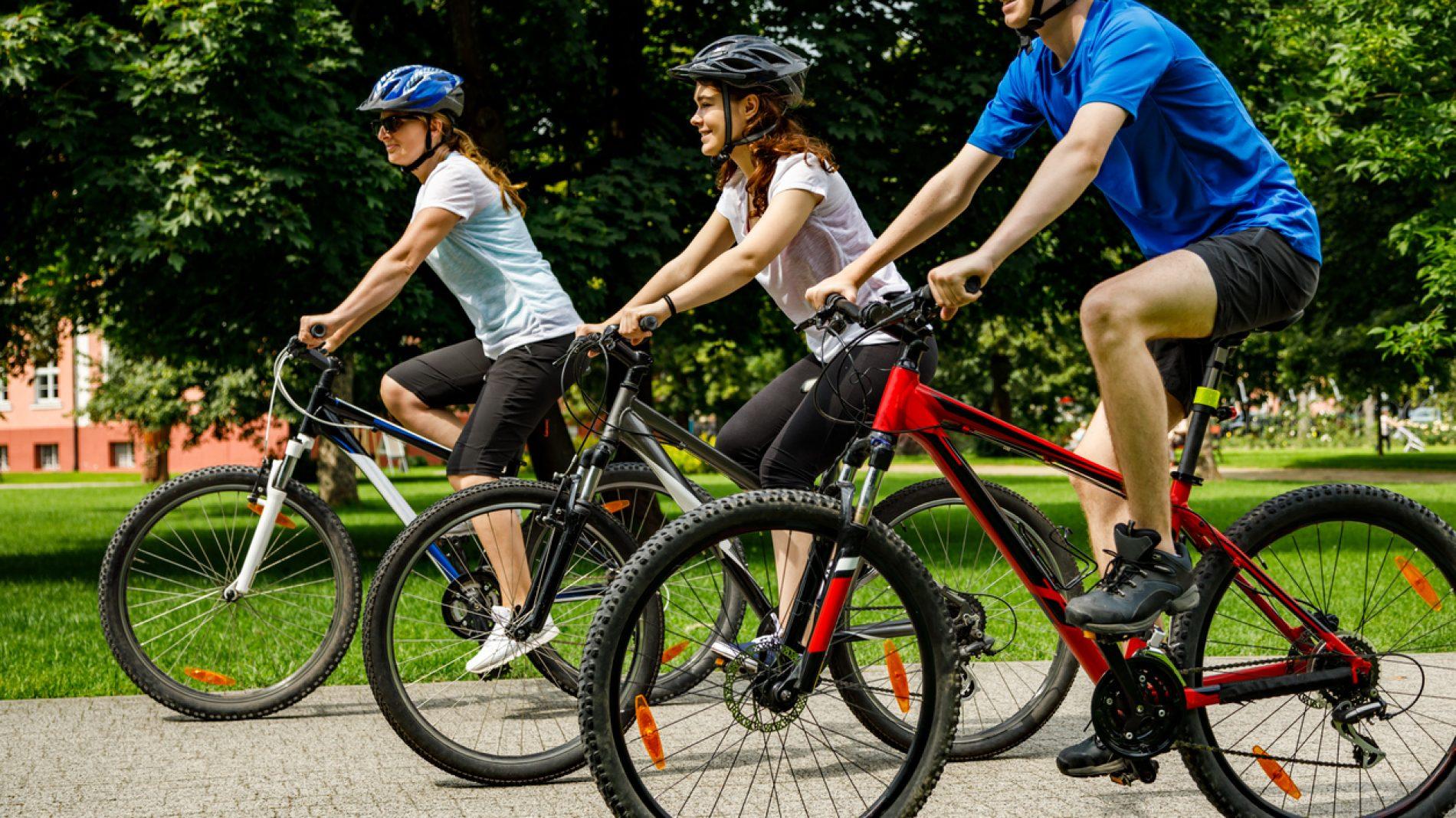 Urban biking- three people riding bikes in city