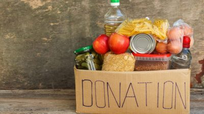 A donation box filled with food