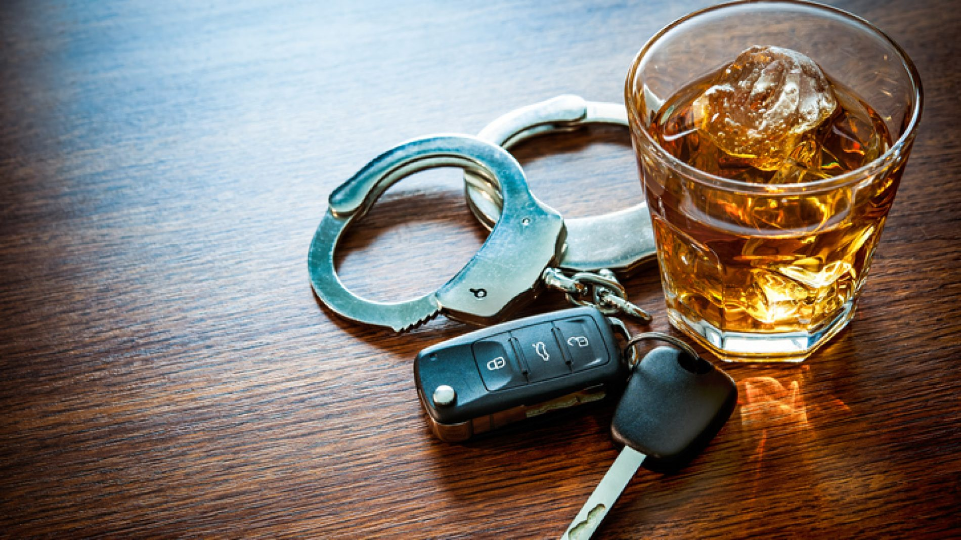 alcohol, keys and handcuffs