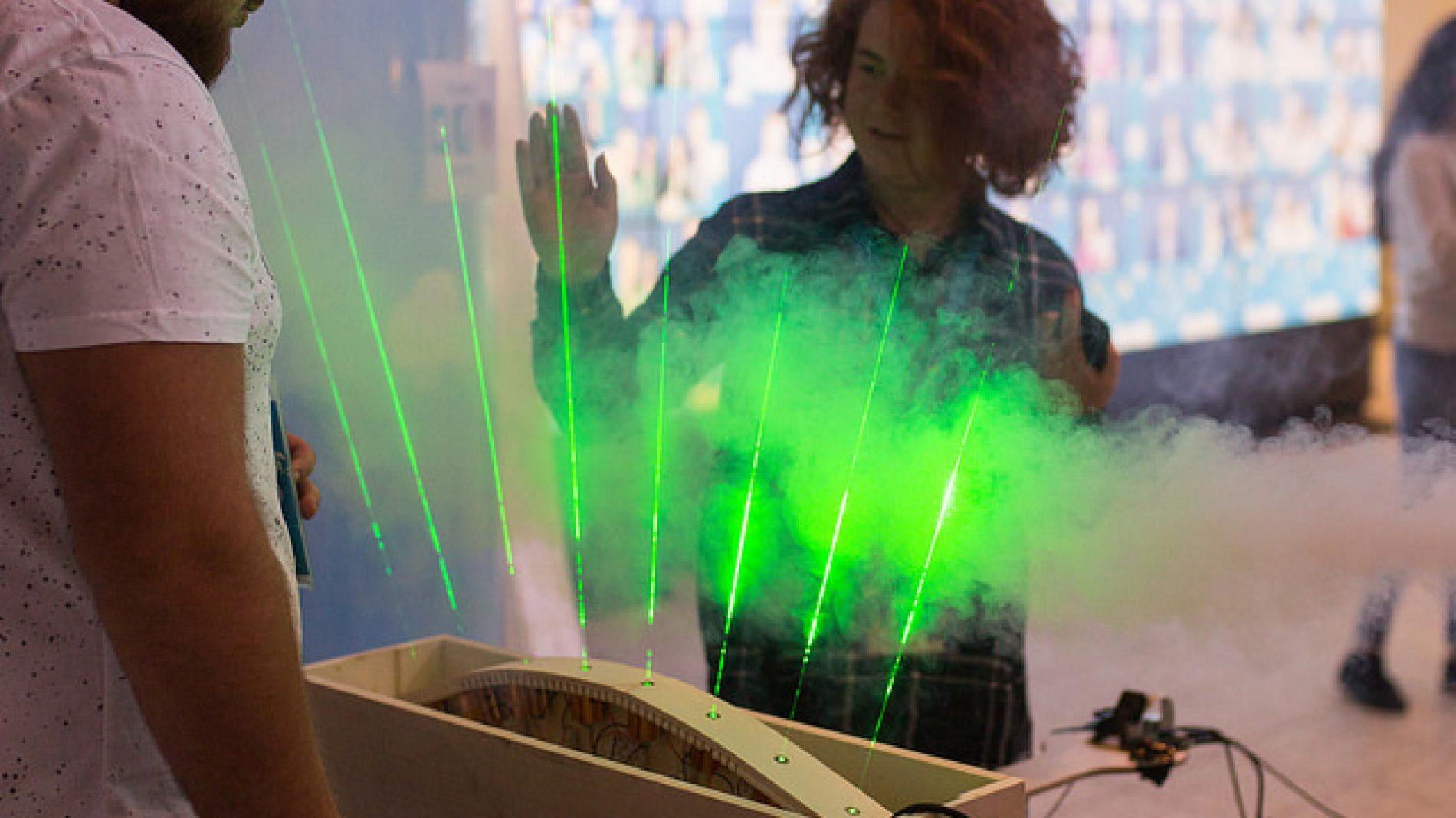 A participant at EUCYS 2017 looking at a light display