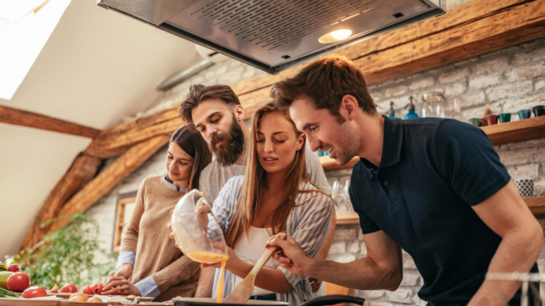 Four-friends-cooking-together-evJTai