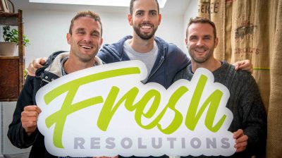 Jamie White and Happy Pear Twins holding Fresh Resolutions sign