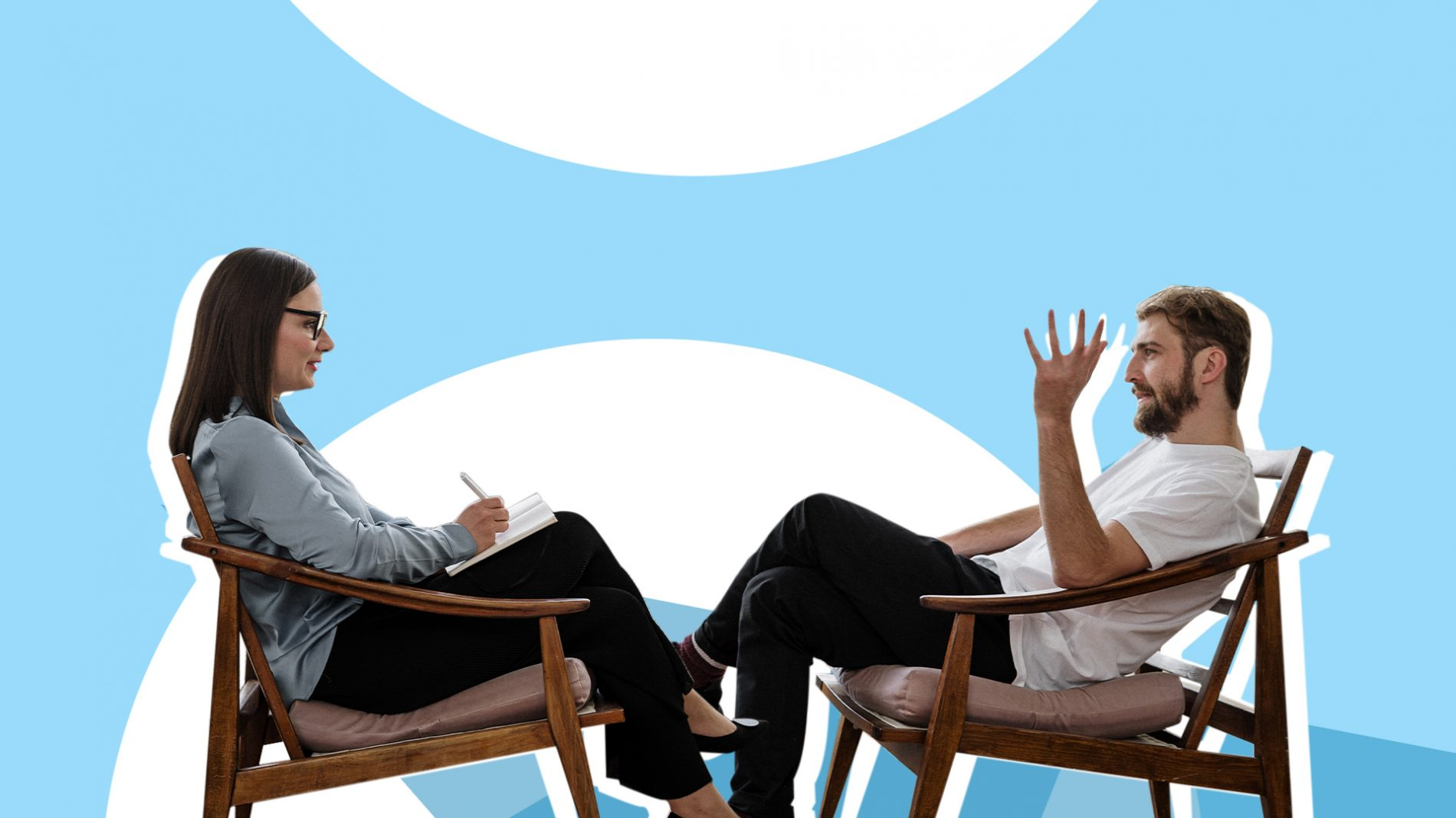 A man sitting with a therapist