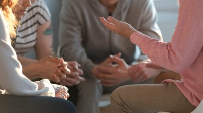 Group-of-young-people-discussing-an-issue-tclnNT