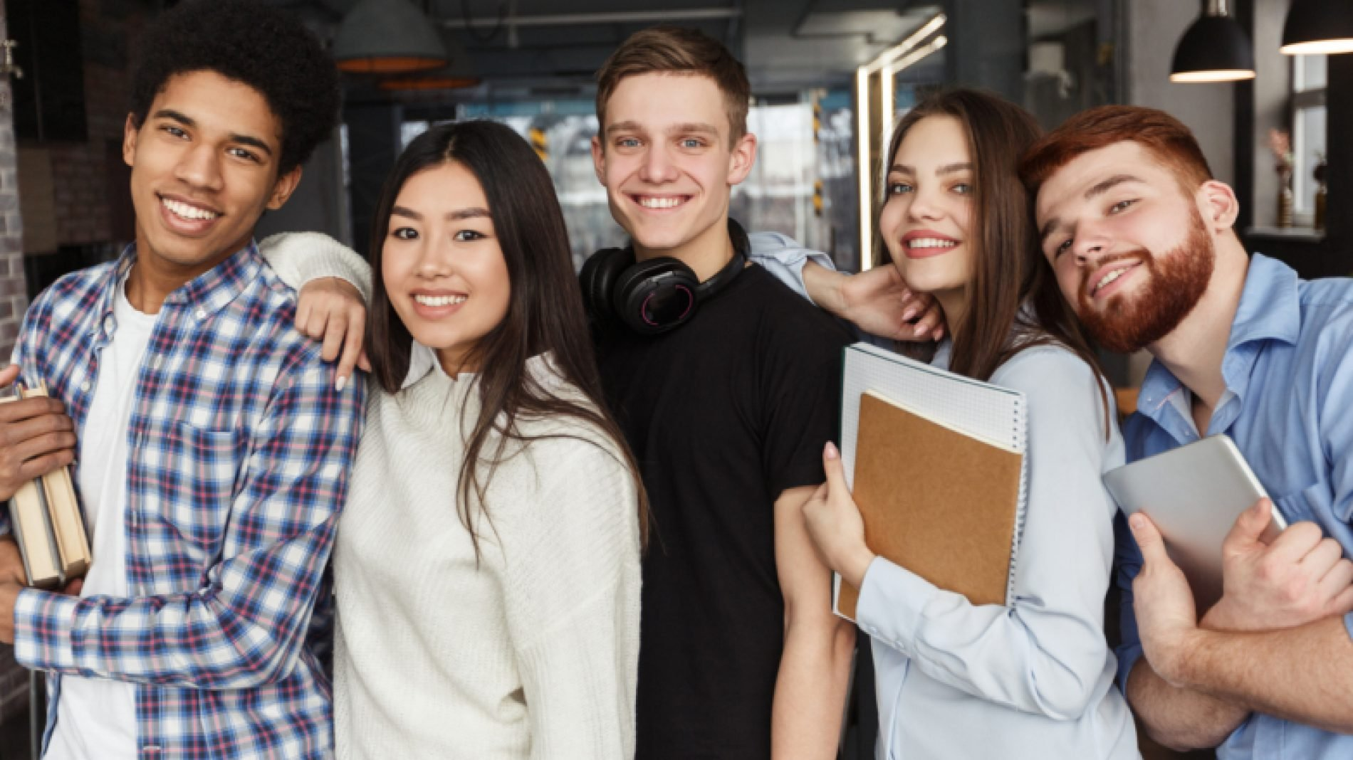 Group-of-young-people-with-notebooks-uFI2XC