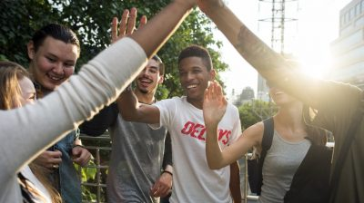 Friends giving high fives