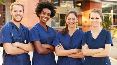 Portrait Of Medical Team Standing Outside Hospital