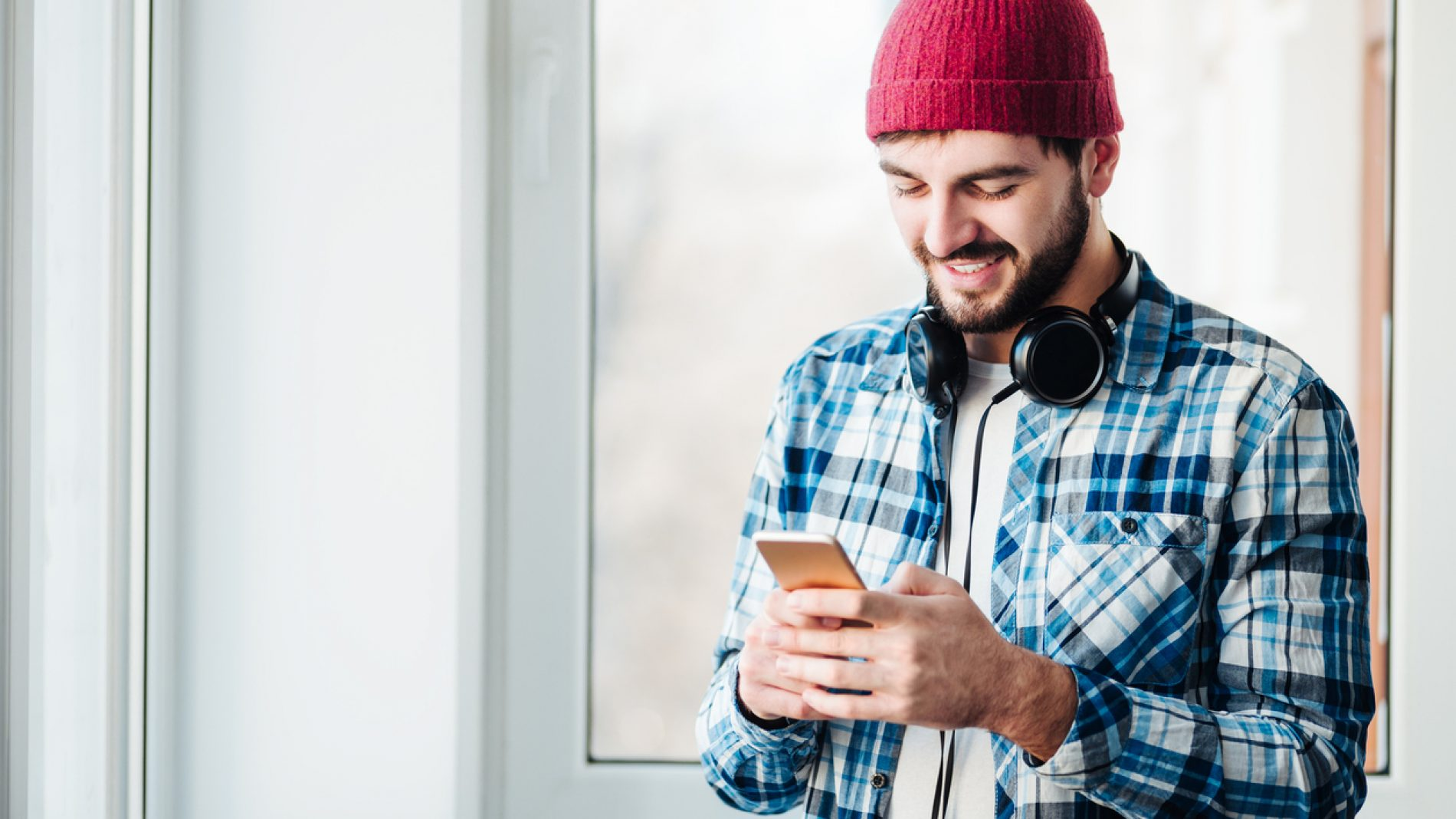 guy using a phone to listen music