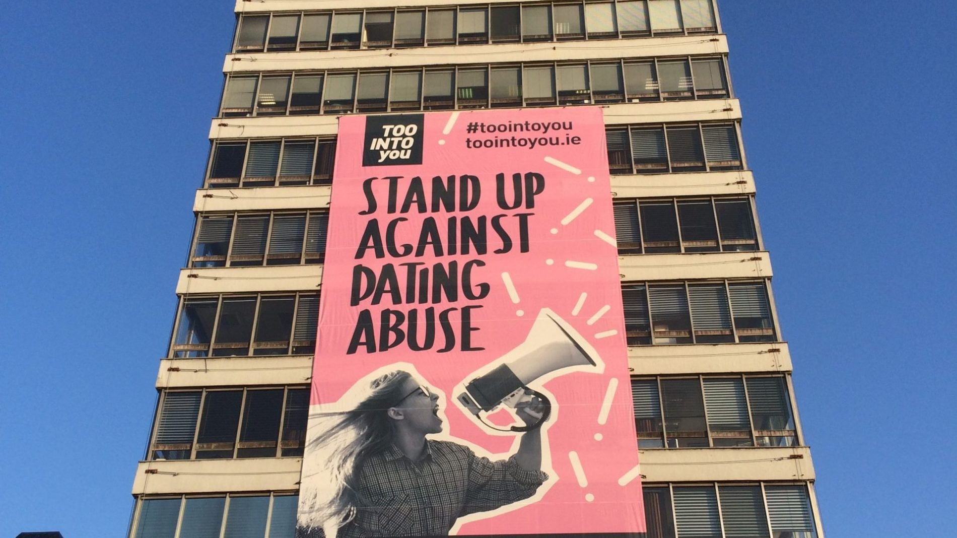 Women's aid poster on side of Liberty Hall