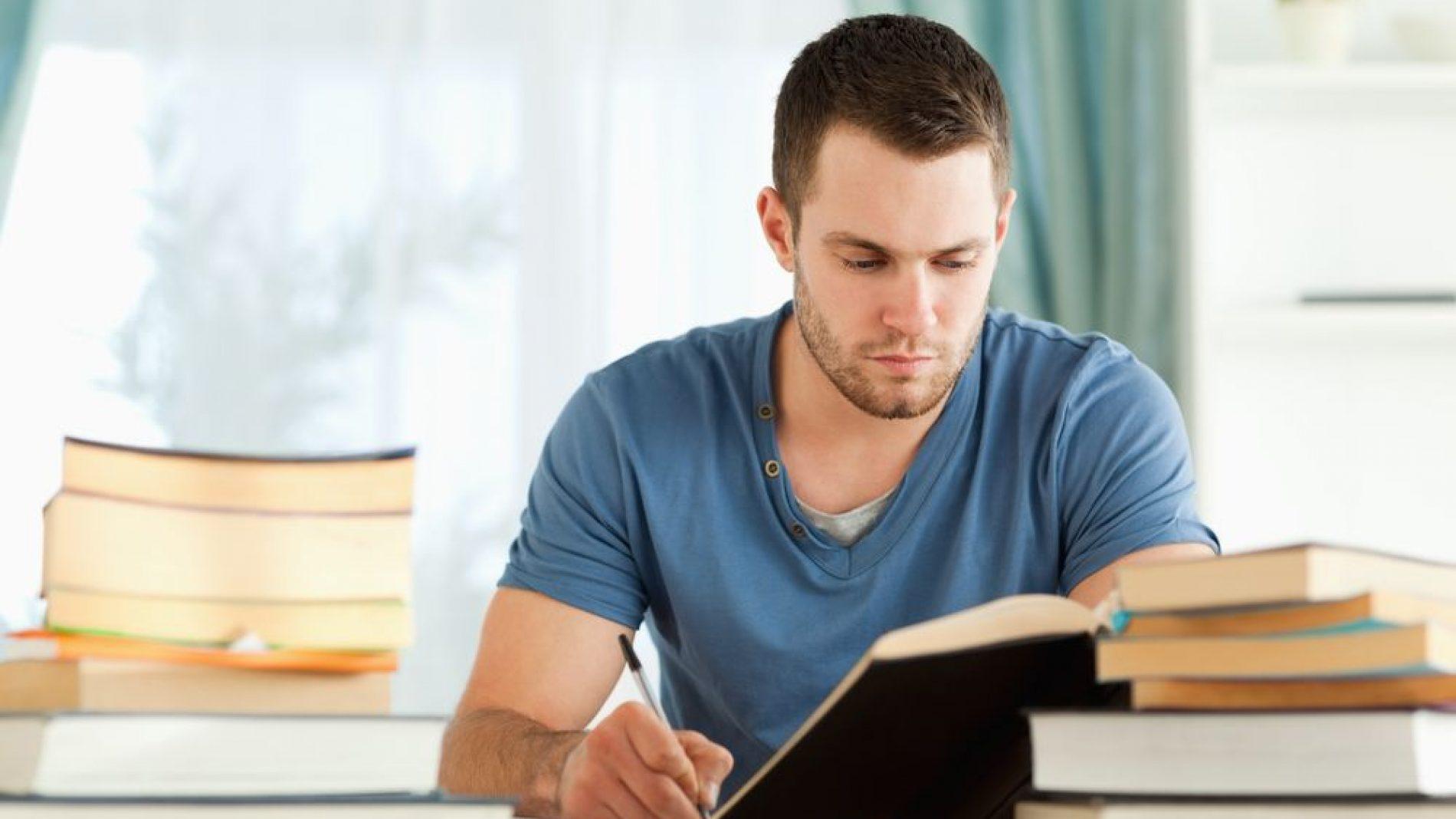 Man-studying-books