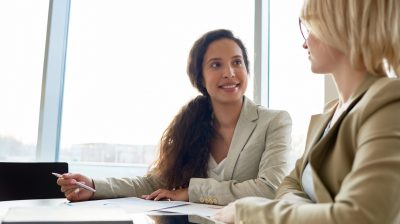 Young woman meeting with her boss