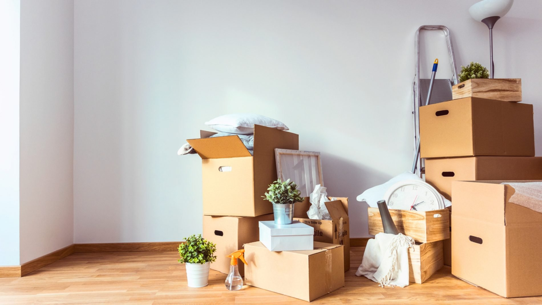 Moving boxes in the corner of a room