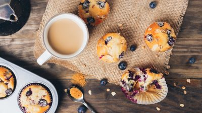 Blueberry muffins breakfast on a rustic table