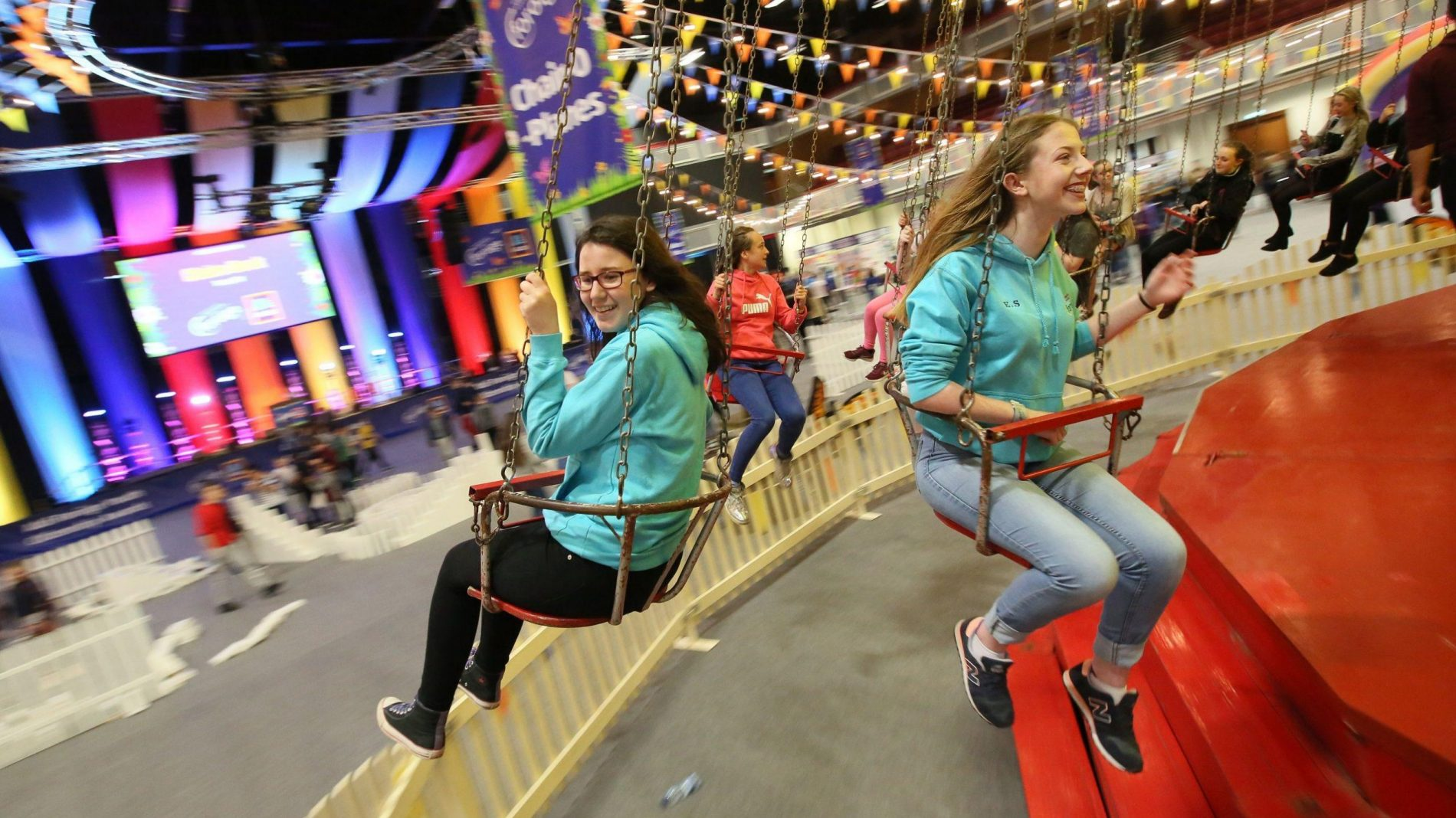Two participants enjoying a funfair ride at the Youth Citizenship Awards