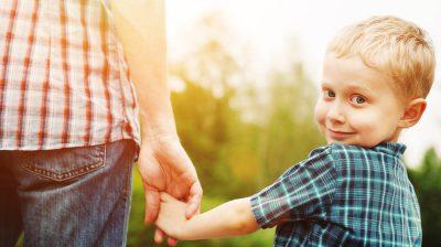 ParentHoldingHandshutterstock_109976480