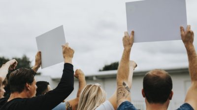 Protesters-holding-up-signs-43yPr2
