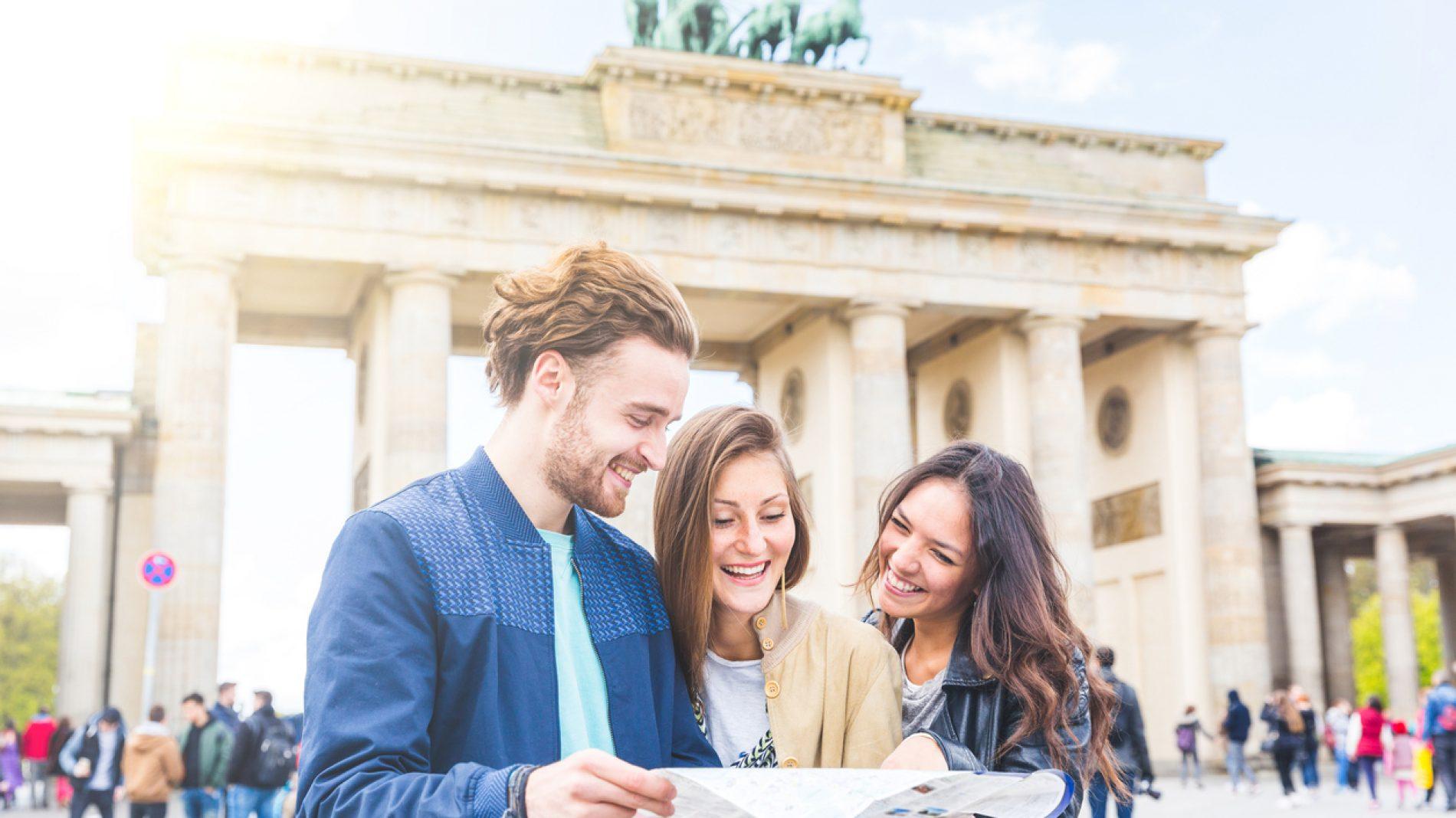 Three friends reading a map in Berlin