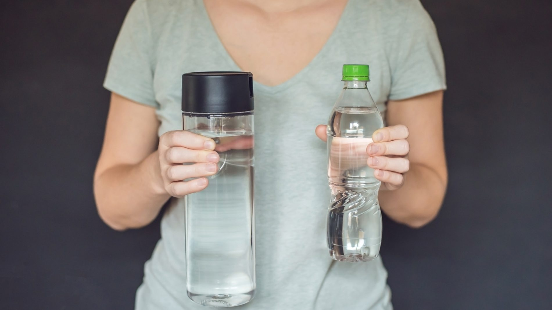 Zero waste concept. Use a plastic bottle or a glass bottle. Zero waste, green and conscious lifestyle concept. Reusable on the go drink container ideas.