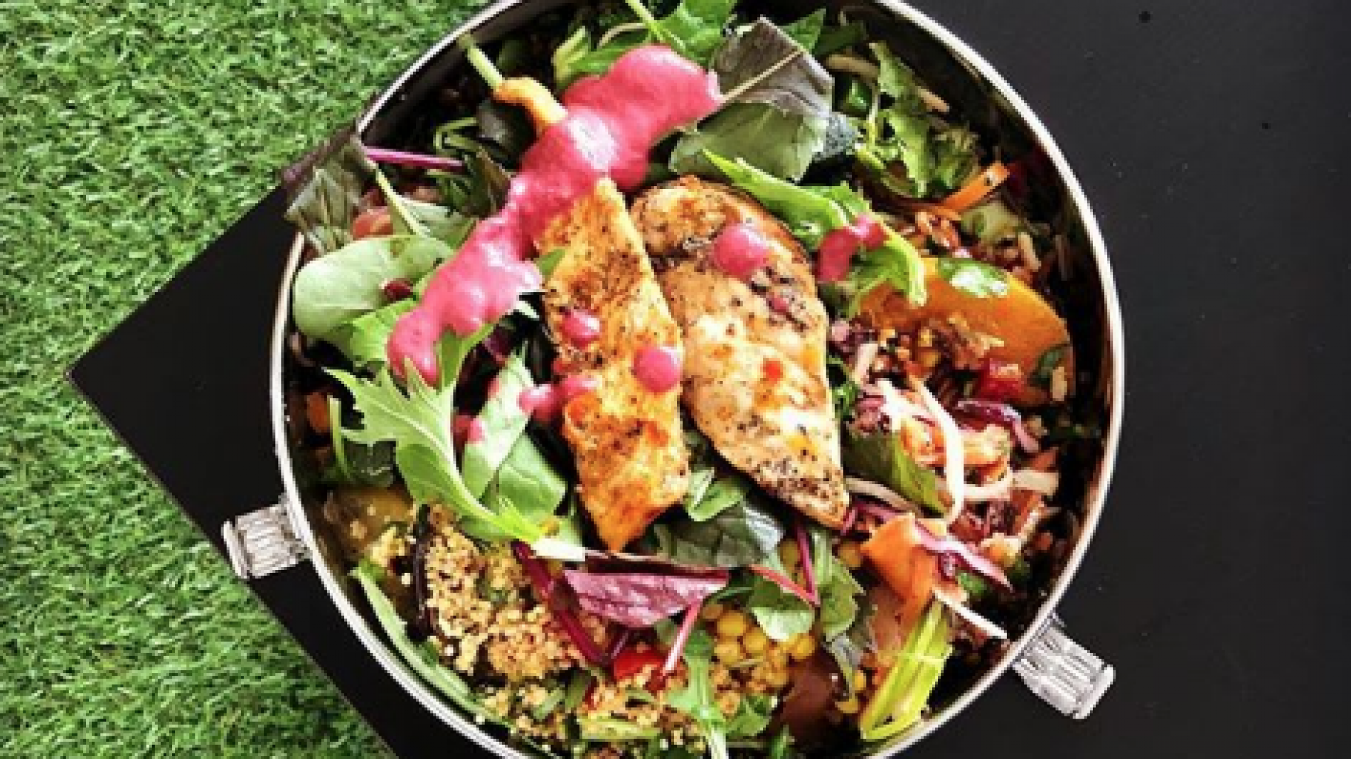 Stainless steel bowl full of salad