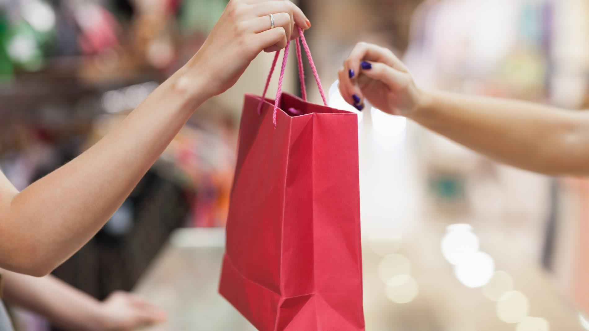 Handing over shopping bag