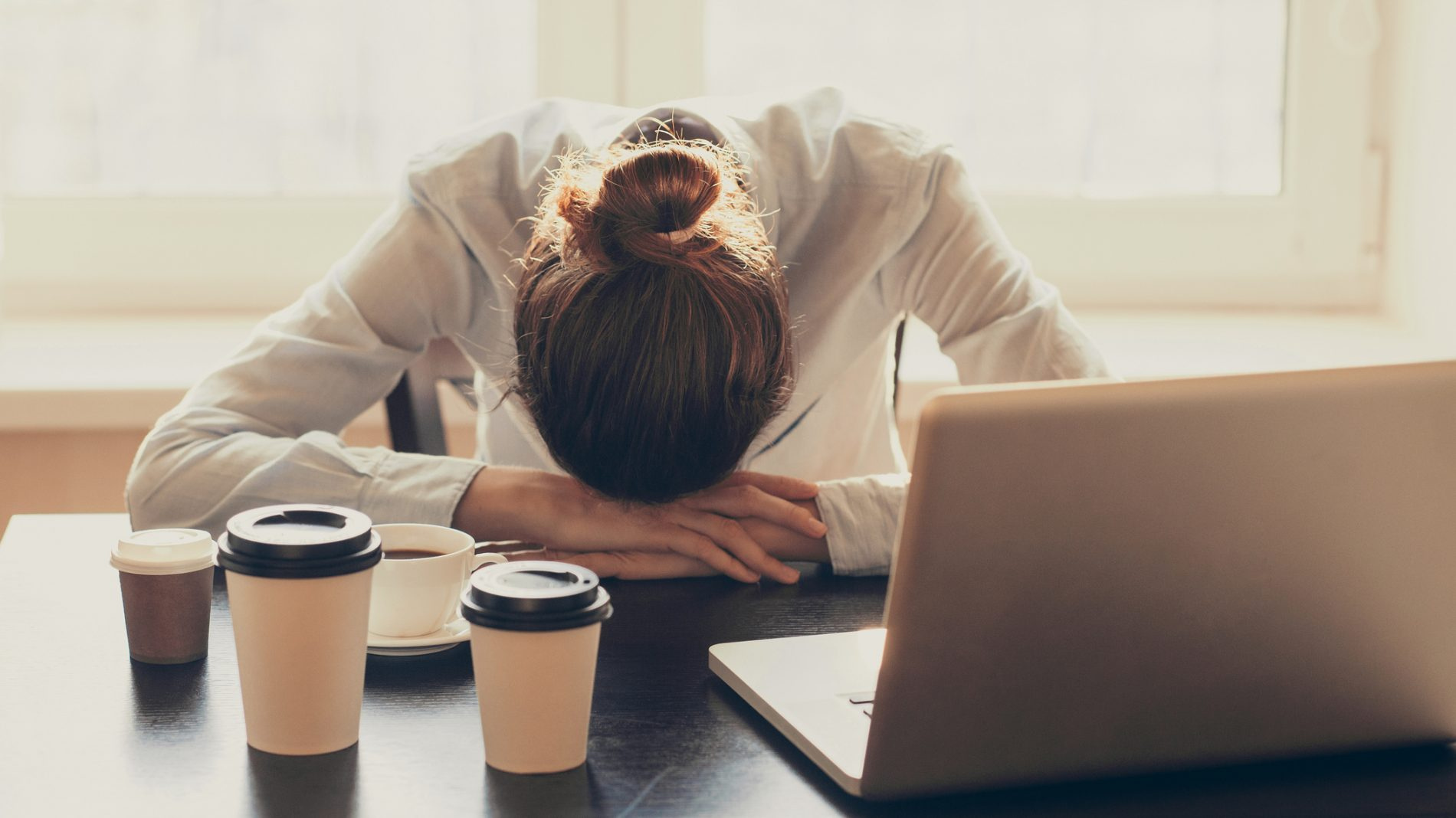 Tired woman in the office