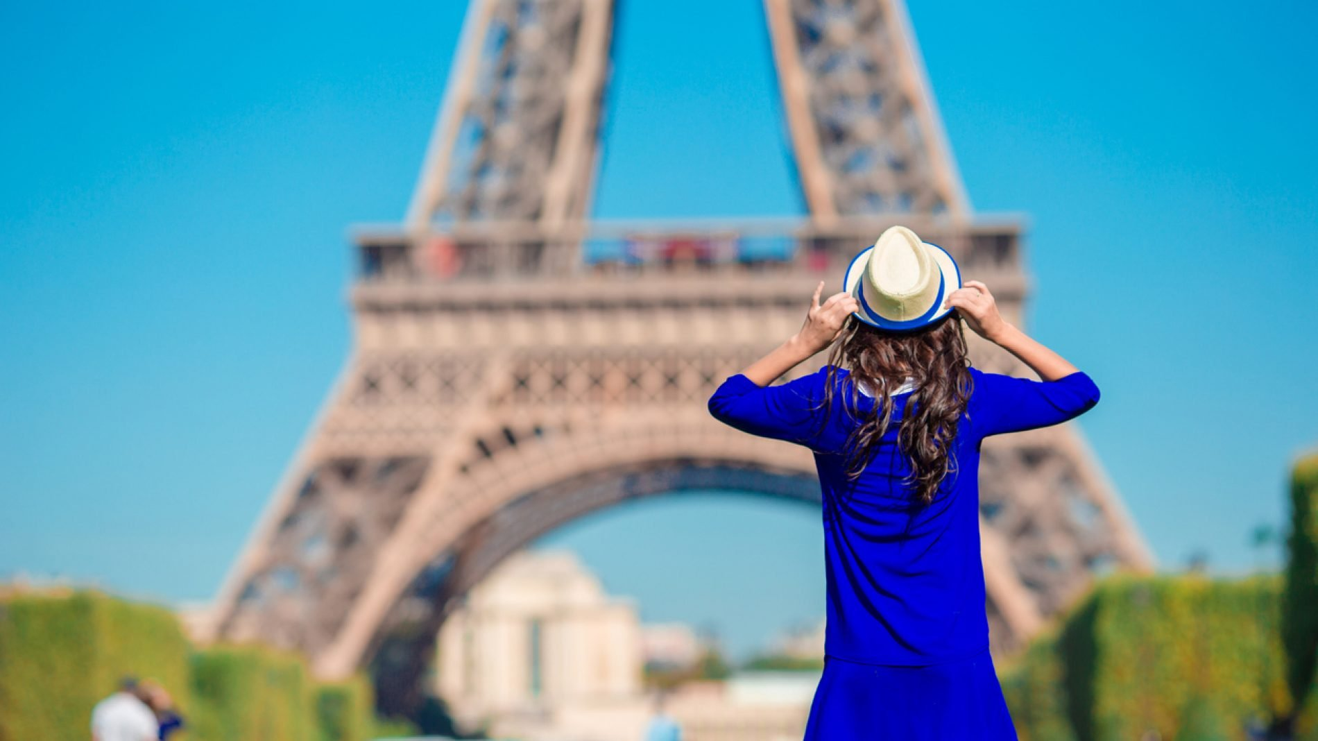 Beautiful woman in Paris background the Eiffel tower during summer vacation