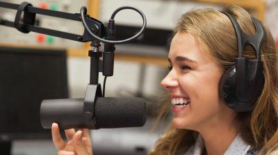 Laughing pretty radio host moderating