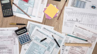 saving concept - tax form, budget, notepad, pen, calculator