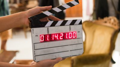image of a clapper board on a movie set