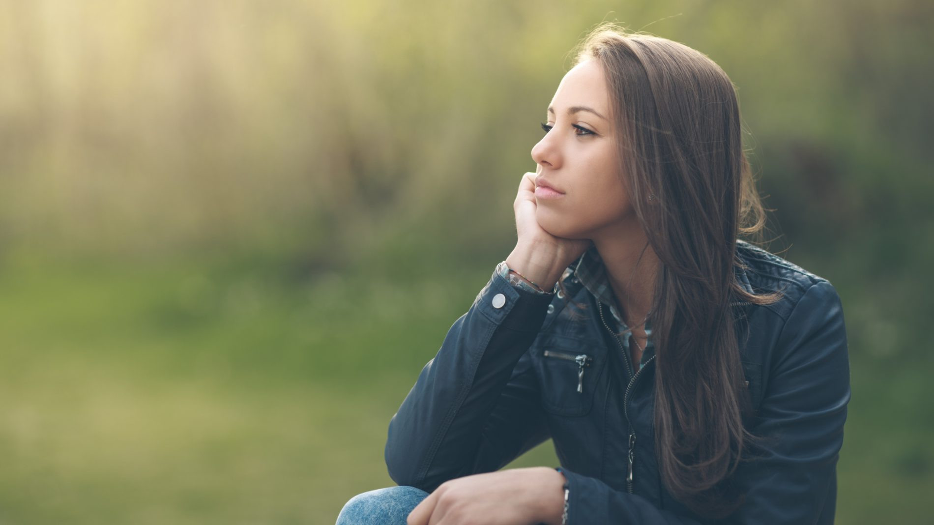 Young woman sitting outdoors