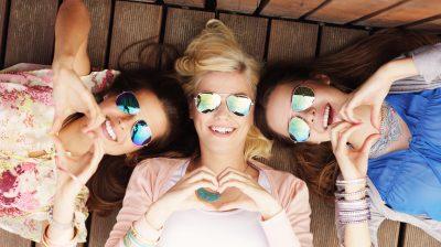 three young women lying down