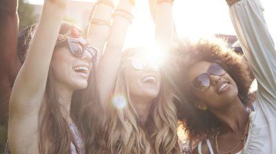 Friends dancing among bright sunbeams