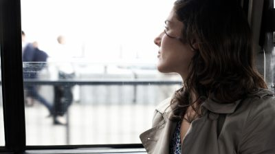 Woman travelling in taxi looking out of window