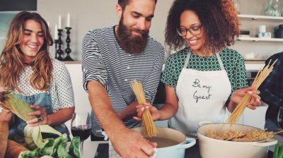 Three-friends-cooking-dinner-Q7OBuB