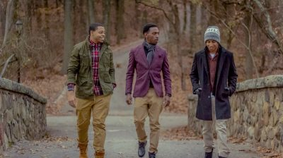 Three friends walking outside together