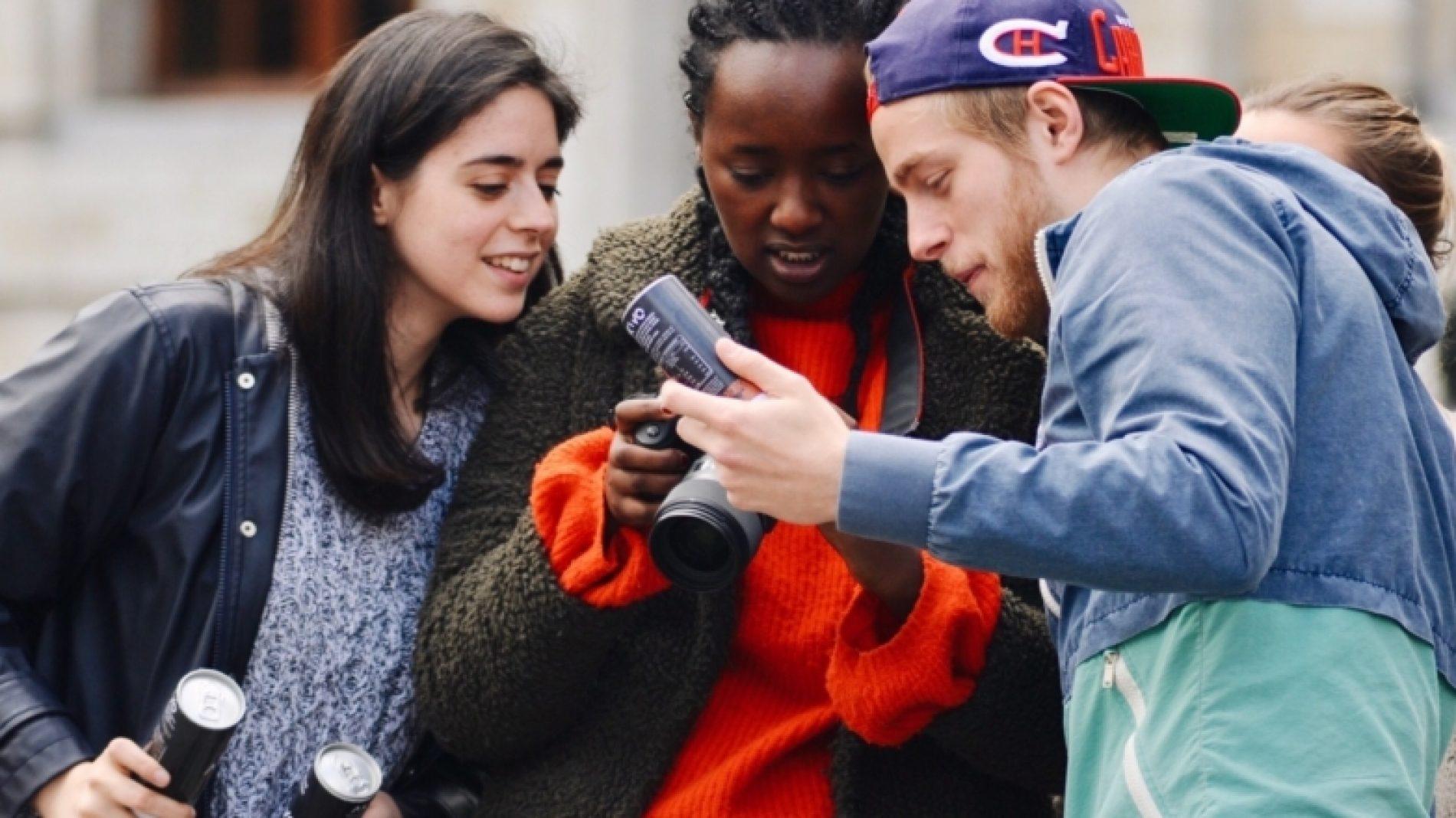 Three-young-people-looking-at-photos-ko2jId