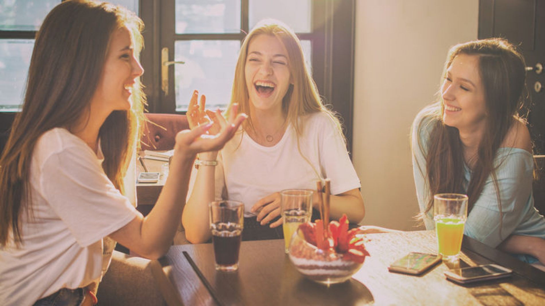 Three_women_chatting_at_table
