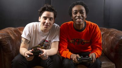 Two non binary friends playing video games together