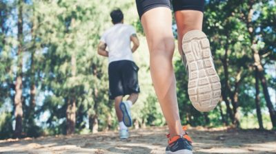 Two-people-running-in-a-park-wMaBS9