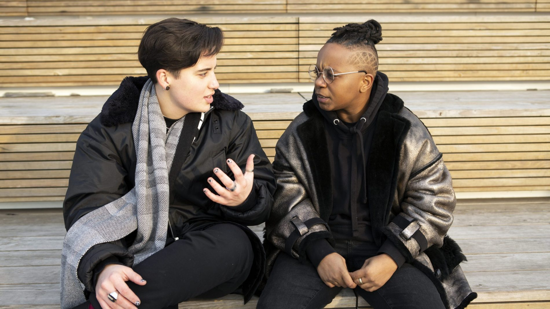 Two trans young people taking together