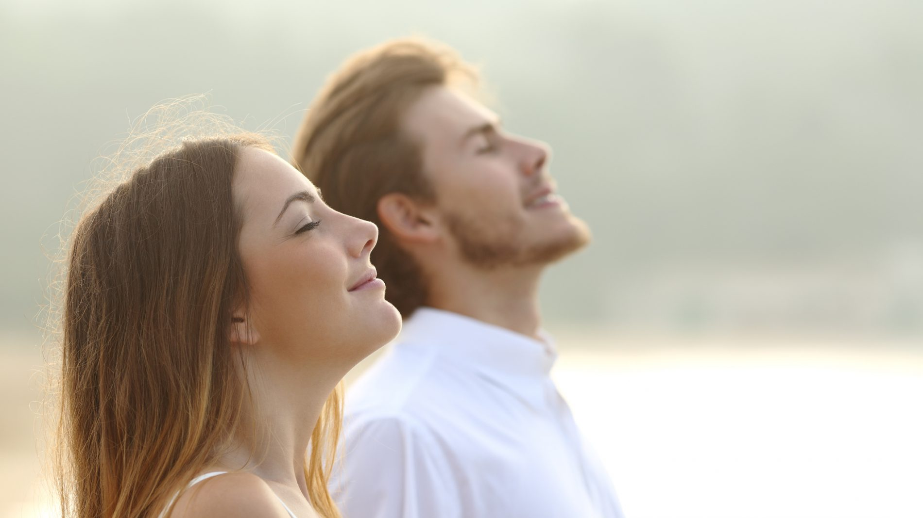 Man and woman breathing in