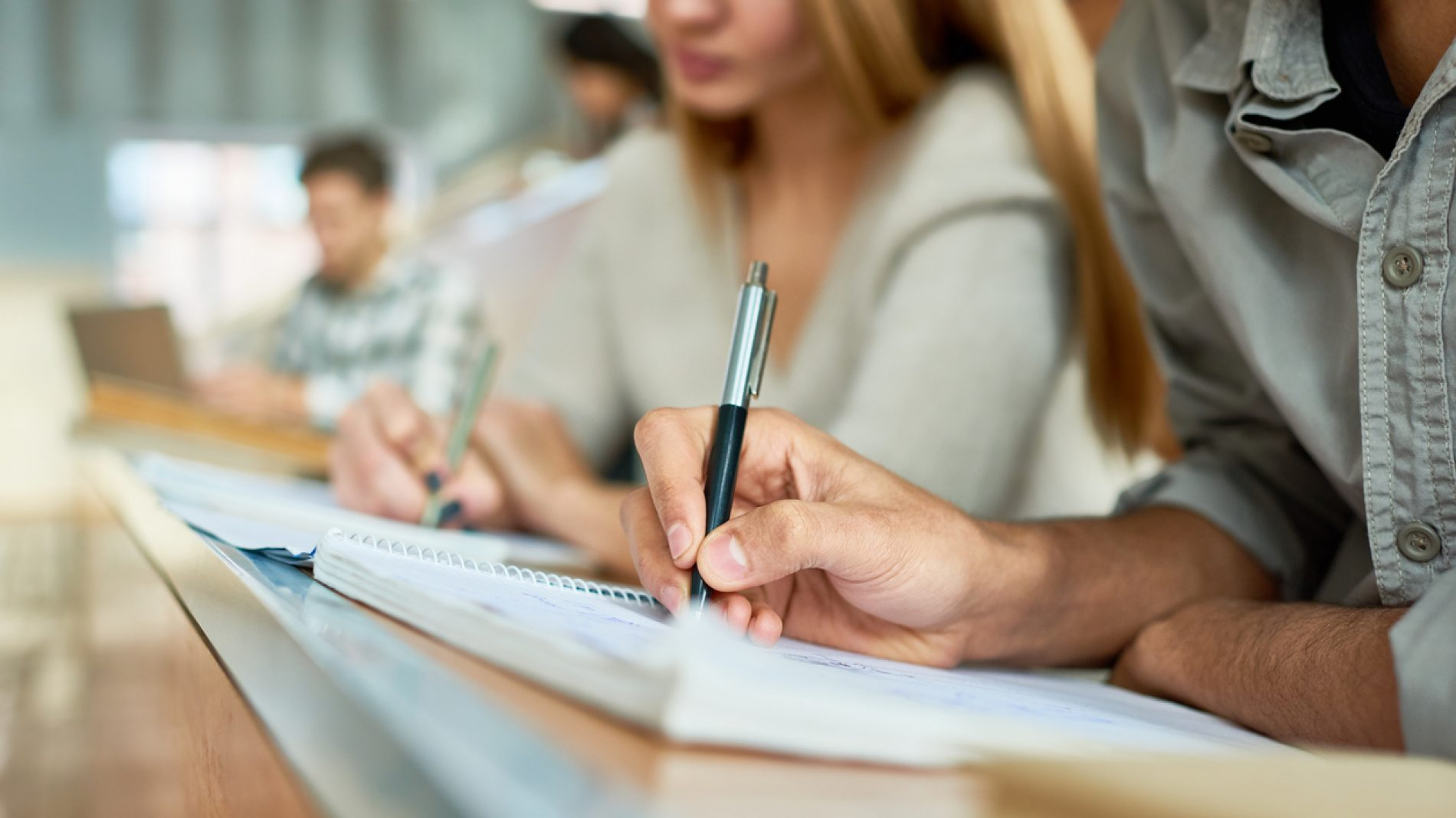 Students writing in a notebook