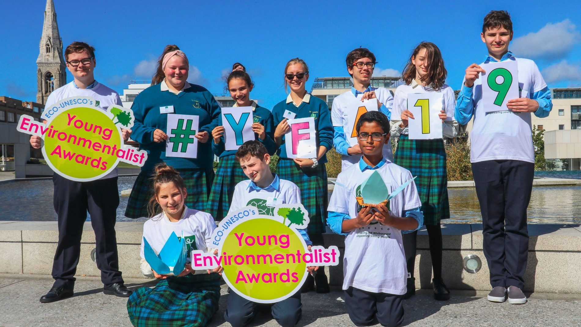 Official YEA 2019 photo - students holding signs