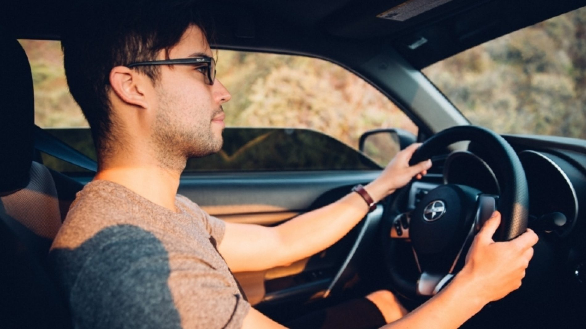 Young-man-driving-a-car