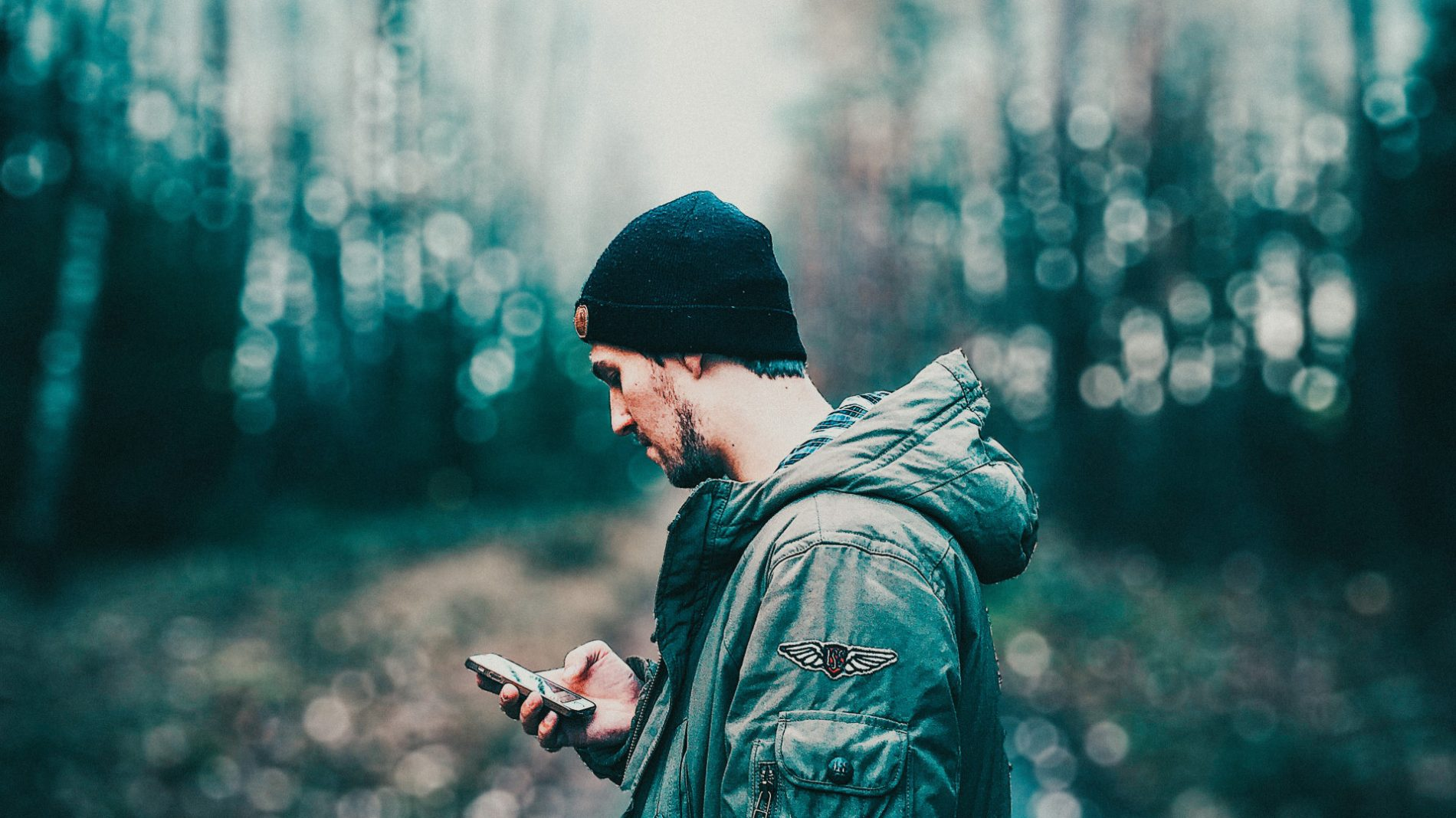 Young man looking at social media on his phone