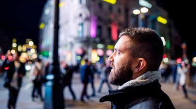 Young-man-looking-at-street-lights