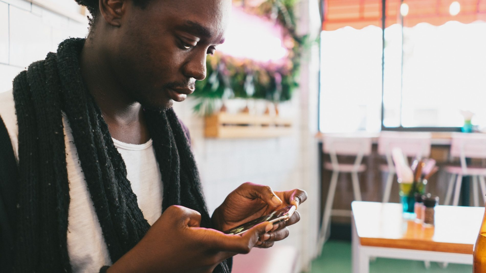 Young man deleting social media from their phone