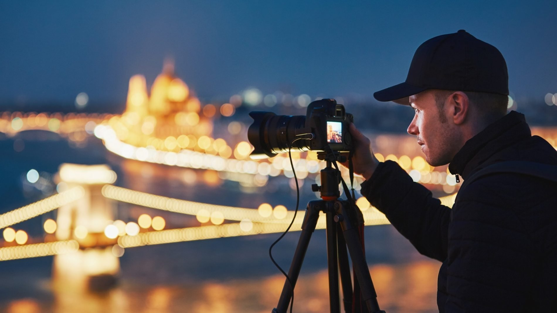 Young man taking a photo of a city